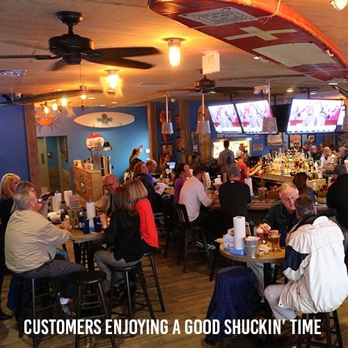 Customers Enjoying A Good Shuckin' Time