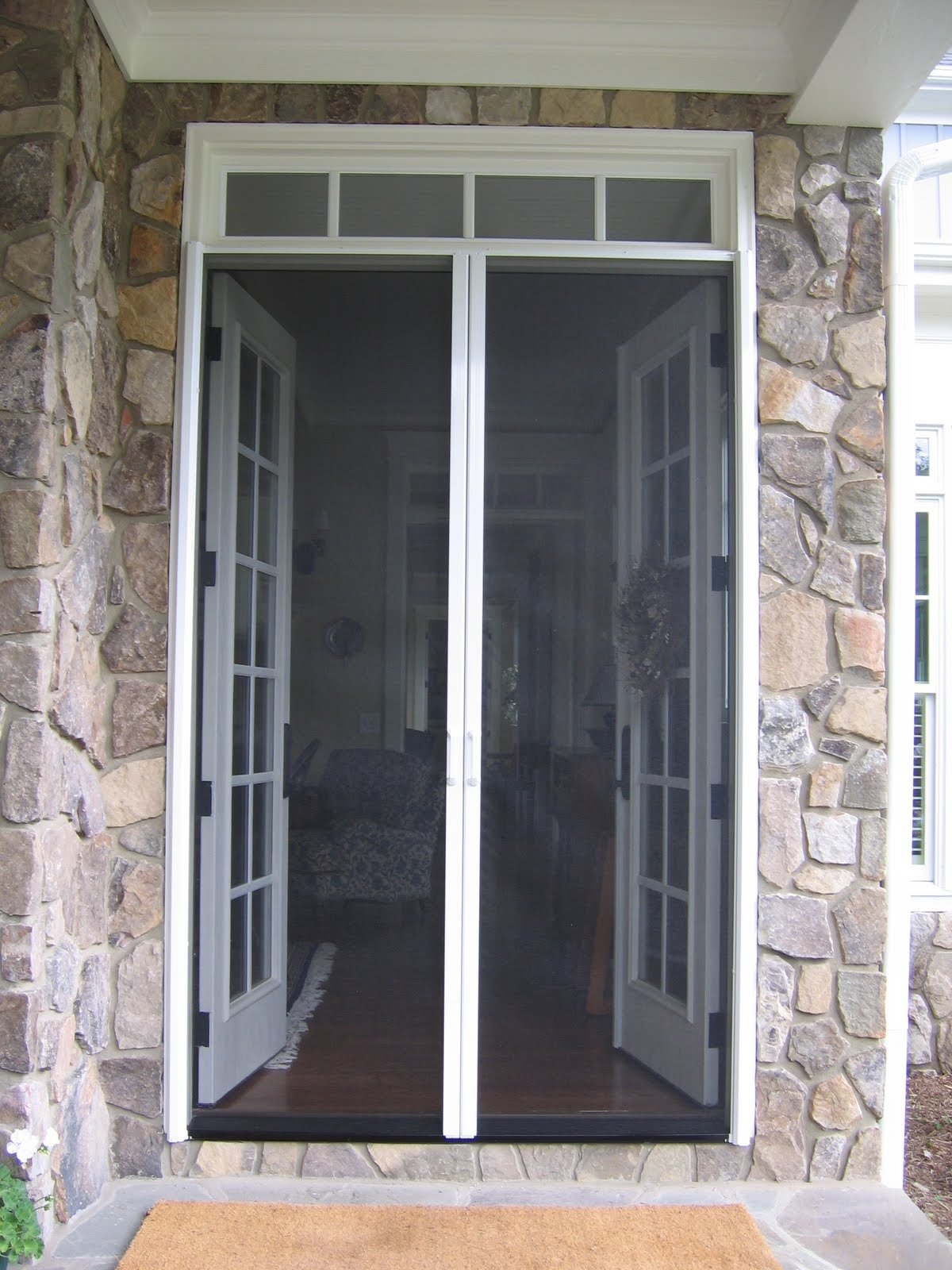 orange tan we of recent black installation installed out in housing that mesh stowaway county retractable a screens img desert door doors fiberglass this colored single with check los screen edited angeles and