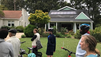 Cyclists toured Plaza Midwood on Saturday to learn more about home solar panels. CREDIT: MICHAEL FALERO / WFAE
