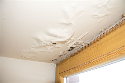 Water damaged ceiling from leaky roof